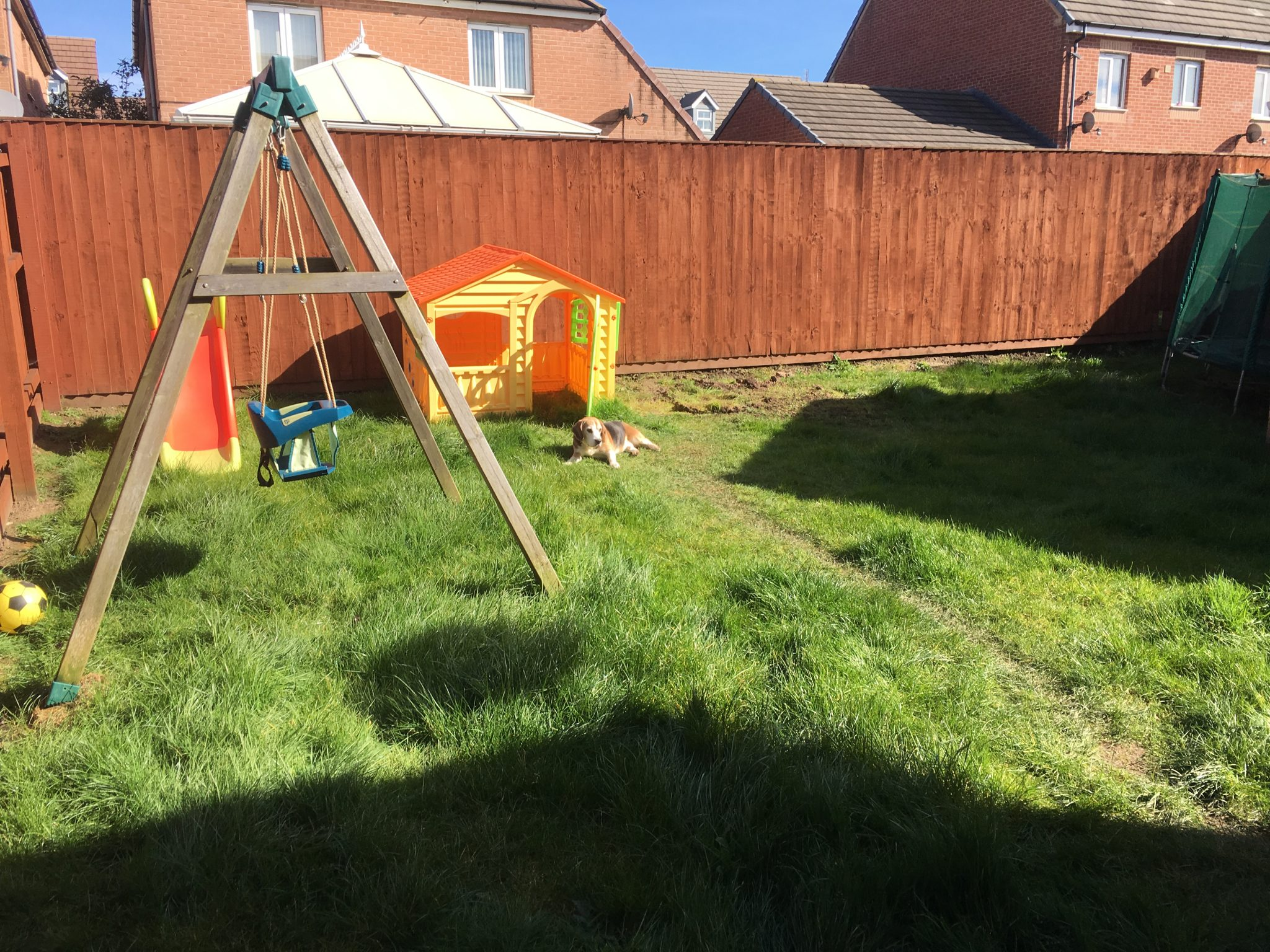Old lawn with childs play area