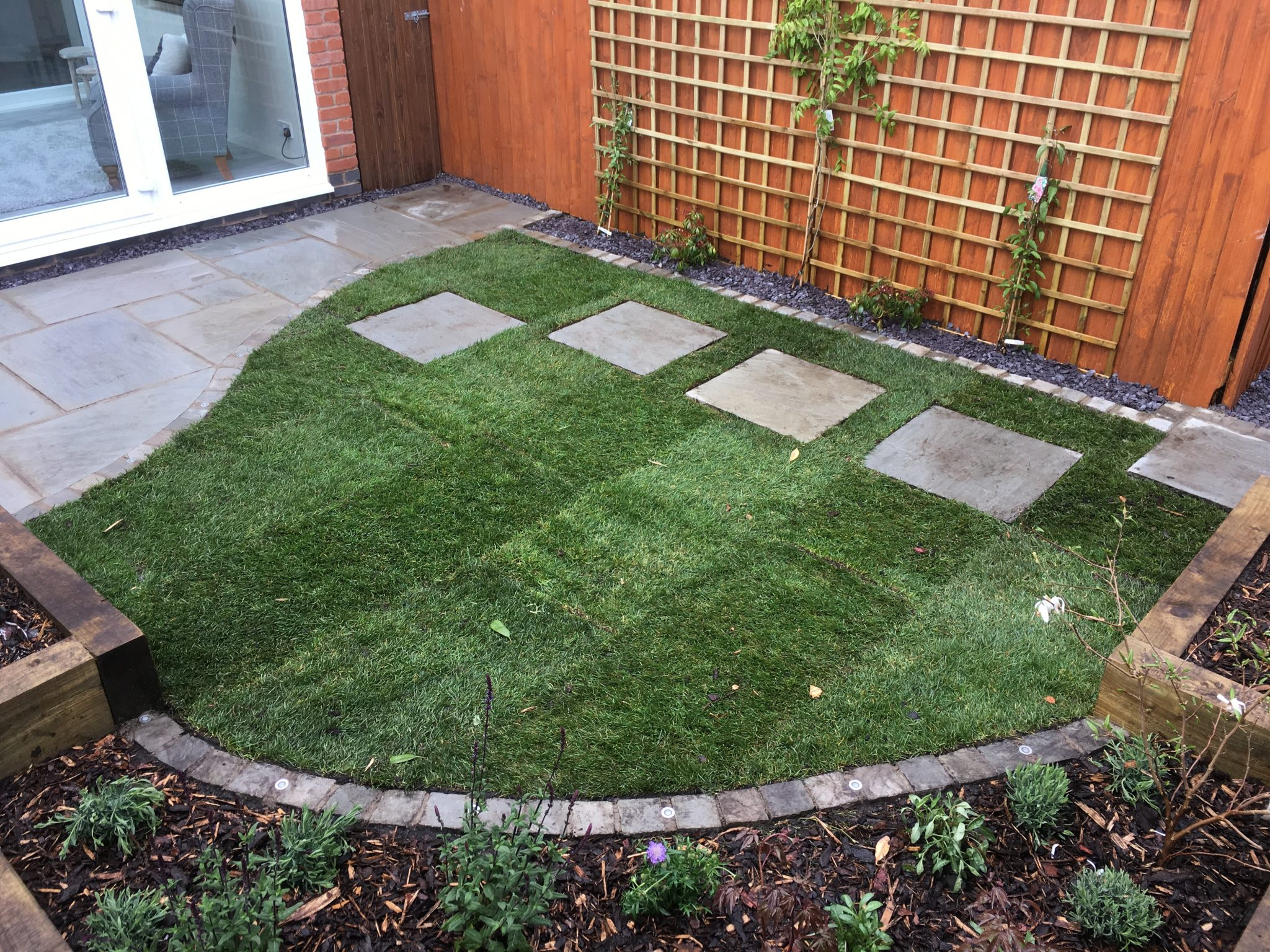 lawn with paving slabs