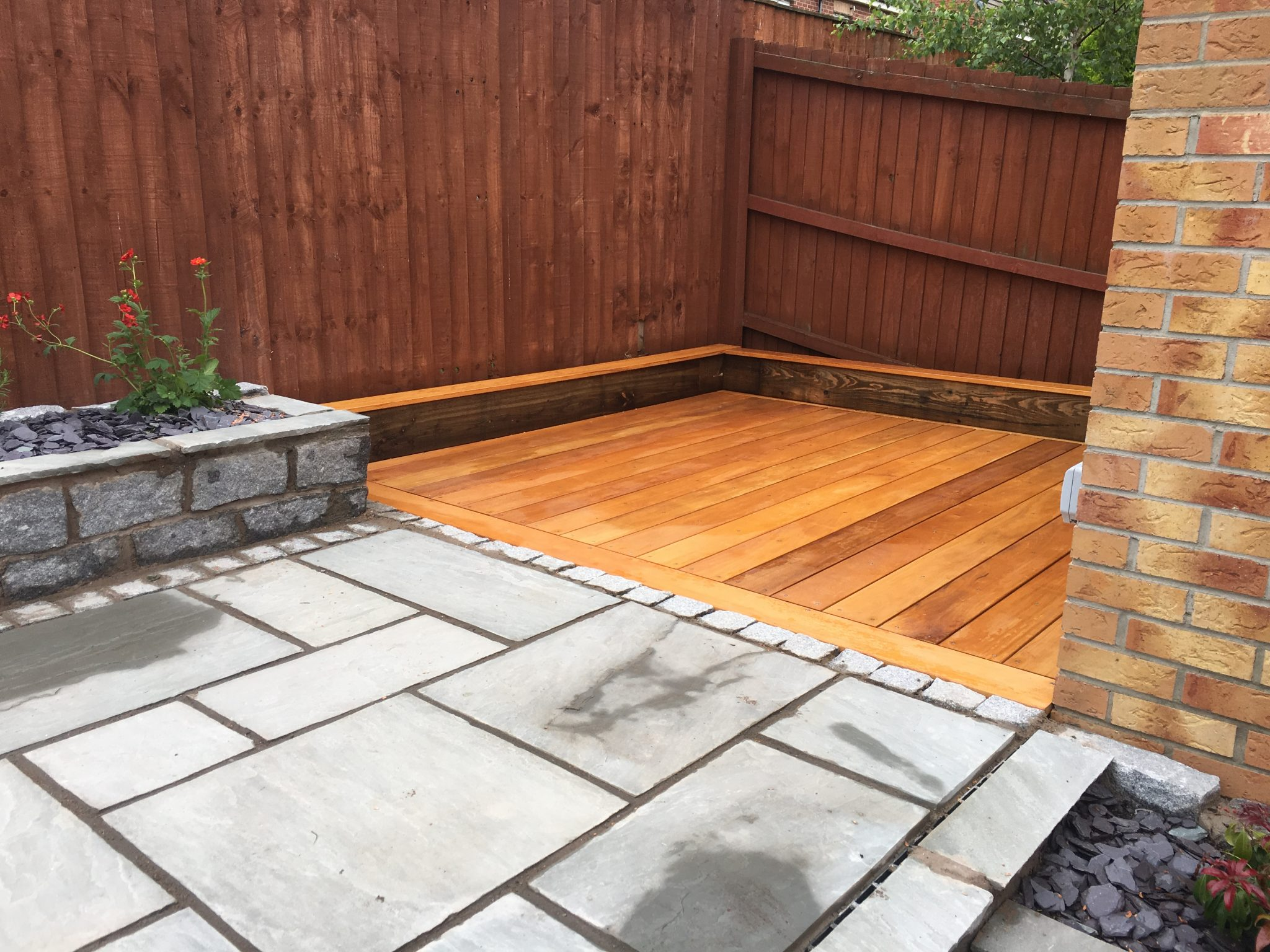 decking in corner of garden