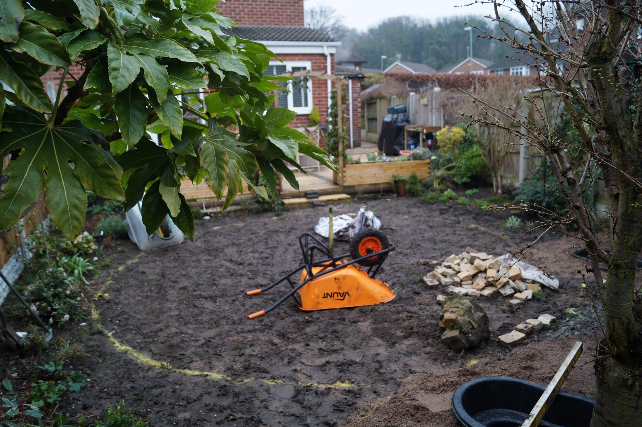 Garden in progress. Wheel barrow upside down
